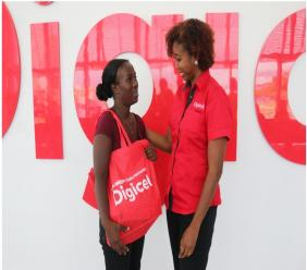 Monique McLeod, Marketing Director at Digicel Group (at right) offers a few words of encouragement to Ackaisha Green after officials from the telecommunications service provider reached out and rewarded the 'Good Samaritan' for her kind deed.