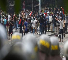 Supporters of the losing presidential candidate clash with police Wednesday, May 22, 2019, in Jakarta, Indonesia. (AP Photo/Achmad Ibrahim)
