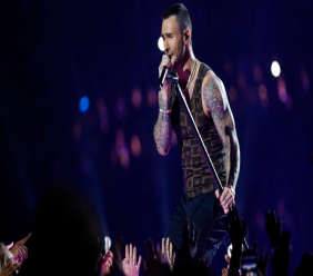 "FILE - In this Feb. 3, 2019 file photo, Adam Levine, of Maroon 5, performs during halftime of the NFL Super Bowl 53 football game between the Los Angeles Rams and the New England Patriots in Atlanta. Levine is leaving NBC's ""The Voice"" after 16 seasons. Carson Daly made the announcement Friday morning, May 24 on the ""Today"" show. Daly said Gwen Stefani will return for season 17 in Levine's chair. (AP Photo/Mark Humphrey, File)"
