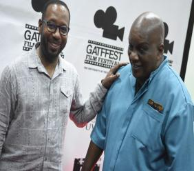Gatffest director Ian Boxhill (left) with local filmmaker Lennie Little-White at the launch of the festival on Thursday. (PHOTOS: Marlon Reid)