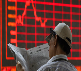 A Chinese investor reads his newspaper at a brokerage in Beijing Wednesday, June 12, 2019. Shares were mostly lower in Asia on Wednesday and Hong Kong's Seng index tumbled 1.7% as thousands continued protests against proposed legislation that many city residents fear could further erode the territory's legal autonomy. (AP Photo/Ng Han Guan)