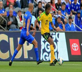 Jamaica's Kevon Lambert (right) takes control against Gino van Kessel of Curaçao during their Group C match of Concacaf Gold Cup on June 25, 2019 at Banc of California Stadium in Los Angeles, California.