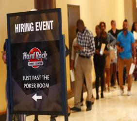 Job applicants line up at the Seminole Hard Rock Hotel & Casino Hollywood during a job fair in Hollywood, Florida. (AP Photo)