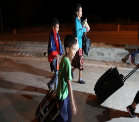Venezuelan migrants walk on the Pan-American Highway outside an immigration office in an attempt to cross from Ecuador into Peru moments after stricter entry requirements went into effect, in Tumbes, Peru, Saturday, June 15, 2019. With its relatively stable economy and flexible immigration laws, Peru has become a main destination for millions of Venezuelans escaping hyperinflation, medical shortages and political repression at home. (AP Photo/Martin Mejia)