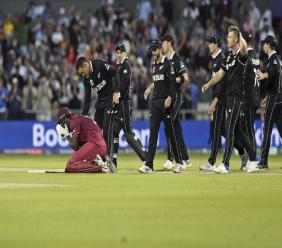 New Zealand's Ross Taylor consoles West Indies' Carlos Brathwaite at the end of the Cricket World Cup match  at Old Trafford in Manchester, England, Saturday, June 22, 2019. (AP Photo/Jon Super)