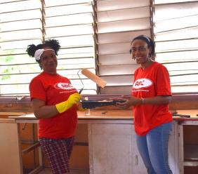 ARC Manufacturing Ltd's Simone Green, Machine Operator and Novlet Deans, Manager – Corporate Affairs weren't afraid to get their hands dirty during the company's renovation project at the Haile Selassie High School.
