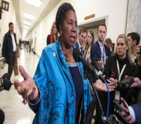 In this Dec. 7, 2018, file photo, U.S. Rep. Sheila Jackson Lee, D-Texas, speaks to reporters on Capitol Hill in Washington. The topic of reparations for slavery is headed to Capitol Hill for its first hearing in more than a decade. Jackson Lee, the resolution's new sponsor, pushed for the hearings, scheduled to begin Wednesday, June 19, 2019. (AP Photo/J. Scott Applewhite, File)
