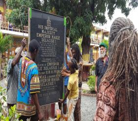 A group of men place a monument commemorating the legacy of  former Ethiopian emperor Haile Selassie I at a section of the Haile Selassie High School compound in St Andrew. (PHOTOS: Marlon Reid)