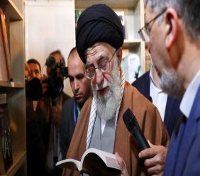 In this picture released on April 29, 2019, by the official website of the office of the Iranian supreme leader, Supreme Leader Ayatollah Ali Khamenei reads part of a book while visiting Tehran's book fair in Tehran, Iran. (Office of the Iranian Supreme Leader via AP)