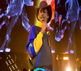 "FILE - This June 1, 2019 file photo shows Lil Nas X performing at HOT 97 Summer Jam 2019 in East Rutherford, N.J. The rapper has taken his ""Old Town Road"" to the top of the Billboard charts for 16 weeks, tying a record set by Mariah Carey and Luis Fonsi. (Photo by Scott Roth/Invision/AP, File)"