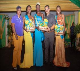 Simone Saunderson (left), assistant depot manager, JP Farms and Mario Figueroa (second right), general manager of Jamaica Producers (JP) Farms representing JP Tropical Foods congratulate the top three contestants in the JCDC Miss St Mary Festival Queen Competition – (from second left) First Runner Up, Jusan Hamilton; Miss St Mary Festival Queen, Sachique Daneika Williams and Second Runner Up Diandrea Eliza Daley --  held on Saturday at the St Mary Anglican Church Hall.