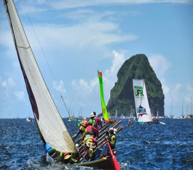 Yole Boat sailing next to the Diamond Rock Photo by Katsuyoshi Tanaka