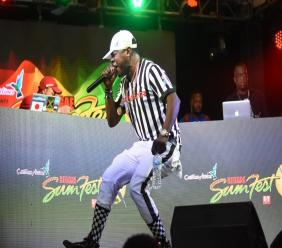 Popular emcee Nuffy reacts after a set during the Sumfest Global Sound Clash on Thursday at Pier One in Montego Bay, St James.
