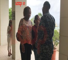 Ninfa Urrutia, Oscar Suarez's mother, looks on as her daughter (center) Susanna cries after hugging Coast Guard Commander (ag.) Ryan Alleyne (right). Standing beside Susanna is Barbados Tourism Product Authority rep Marsha Alleyne.