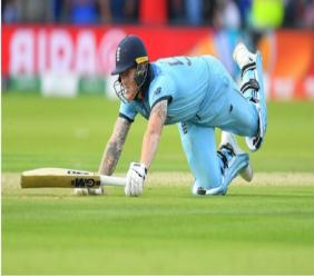 Ben Stokes dives as a fielded ball hits his bat and runs away for a key boundary in the World Cup final.