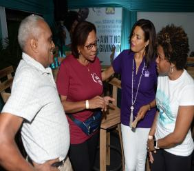 Dr Wendel Guthrie (l to r), gynaecologist, listens as Margaret Johnson, cancer survivor, shares her experiences with Yulit Gordon, executive director, Jamaica Cancer Society and Dr Dana Morris Dixon (centre), chief marketing and business development officer at The Jamaica National Group.