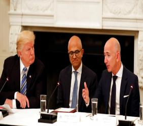 In this June 19, 2017, file photo President Donald Trump, left, and Satya Nadella, Chief Executive Officer of Microsoft, centre, listen as Jeff Bezos, Chief Executive Officer of Amazon, speaks during an American Technology Council roundtable in the State Dinning Room of the White House in Washington. (AP Photo/Alex Brandon, File)