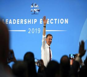 Conservative party leadership candidate Jeremy Hunt leaves the stage after a Conservative leadership hustings at ExCel Centre in London, Wednesday. (AP Photo)