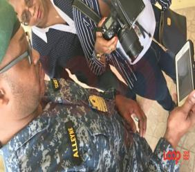 Acting Commander of the Barbados Coast Guard Ryan Alleyne shows search patterns on his phone to the media.