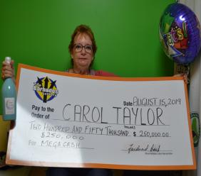 Grateful! Carol Taylor displays her $250,000 cheque after winning The Barbados Lottery's $250,000 Mega Cash Instant Scratch game recently.