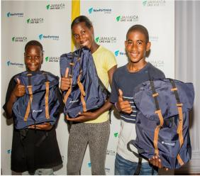 Thumbs up for New Fortress Energy from Jerome Malcolm, Vere Technical High School, Janel Shaw, Garvey Maceo High School D'Andre Bailey from Kempts Hill High School at the Back to School Fair held at the Wembley Centre in Clarendon recently.