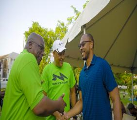 Prime Minister of St Kitts and Nevis, Dr Timothy Harris (left), Minister of Health and Wellness of Jamaica and pioneer of Caribbean MOves, Dr Chris Tufton and Ambassador of St. Kitts and Nevis, Jonel Powell share a delightful moment as they greet each other.