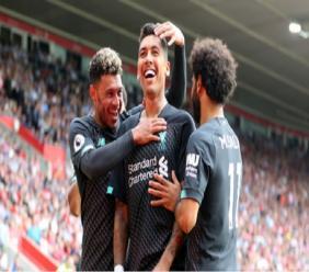 Roberto Firmino celebrates Liverpool's second goal.