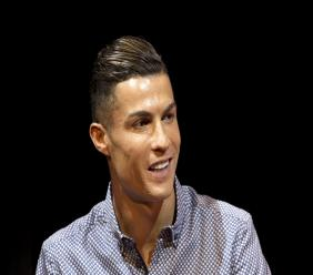 In this Monday, July 29, 2019 file photo Juventus football player Cristiano Ronaldo speaks in Madrid, Spain.