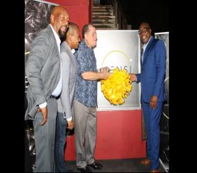 Lloyd Tomlinson (second right), managing director of Marigold Projects, is all smiles during the ribbon-cutting ceremony for the company's medical ganja dispensary, Sensi Medical Cannabis House inside the Pulse complex last Thursday. Joining in the occasion are (from left) Cabinet ministers Ruddy Spencer; Floyd Green and Audley Shaw.