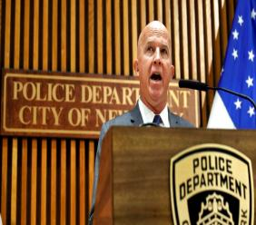 Police Commissioner James P. O'Neill makes an announcement at New York City Police Dept. headquarters, Monday, Aug. 19, 2019. (AP Photo/Richard Drew)