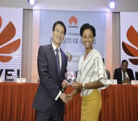 Outgoing Huawei  Country Manager Yue Allen Chen with 2019 Seeds For the Future recipient Tia Thomas from the University of Technology, Jamaica.