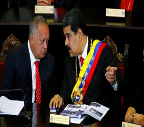 In this Jan. 24, 2019 file photo, Venezuelan President Nicolas Maduro, right, speaks with Constitutional Assembly President Diosdado Cabello at the Supreme Court during an annual ceremony that marks the start of the judicial year in Caracas, Venezuela. (AP Photo/Ariana Cubillos, File)