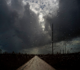 Rain drops cover a car's window shield prior to the arrival of a new tropical depression, that turned into Tropical Storm Humberto, in the aftermath of Hurricane Dorian en route to Mclean's Town, Grand Bahama, Bahamas, Friday Sept. 13, 2019. Humberto narrowly missed the island over the weekend, while it's expected to move over Bermuda later this week. (AP Photo/Ramon Espinosa)