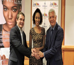 Media Promotions and Public Relations Manager of Port of Spain Fashion Week (POSFW) Crystal Cunningham is flanked by Olivier Maumaire (left), General Manager of HiltonTrinidad and Mayor of Port-of-Spain Joel Martinez during the official media launch of Port-of-Spain Fashion Week.