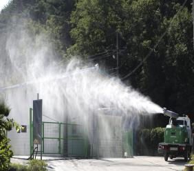 Disinfectant solution is sprayed as a precaution against African swine fever at a pig farm in Yanggu, South Korea, Tuesday, Sept. 17, 2019. South Korea is culling thousands of pigs after confirming African swine fever at a farm near its border with North Korea, which had an outbreak in May. (Yang Ji-ung/Yonhap via AP)
