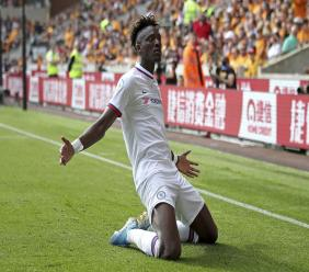 Chelsea's Tammy Abraham celebrates scoring his side's fourth goal of the game and his hat-trick during their English Premier League football match against Wolverhampton Wanderers at Molineux, Wolverhampton, England, Saturday, Sept. 14, 2019. (Nick Potts/PA via AP).