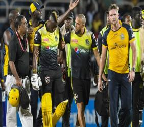 Jamaica Tallawahs' star all-rounder Andre Russell is being taken off the field after he was hit on the back of the head by a Hardus Viljoen bouncer. (PHOTOS: CPL).