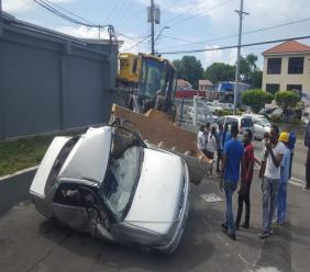 The driver of the Toyota Carina then fell from his vehicle, which was still trapped inside the bucket of the tractor.