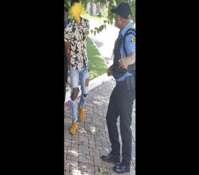 Guardsman Security personnel take a suspect into custody awaiting the arrival of the police after the private security personnel responded to a robbery of a lone female motorist in Russell Heights, St Andrew on Sunday morning.