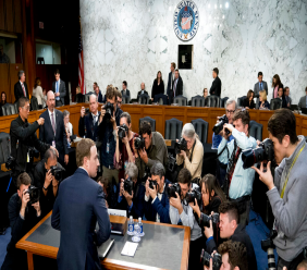 FILE - In this April 10, 2018, file photo, Facebook CEO Mark Zuckerberg returns from a break as he testifies before a joint hearing of the Commerce and Judiciary Committees on Capitol Hill in Washington. (AP Photo/Andrew Harnik, File)