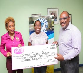 Renee Rose (left), Corporate Programmes Manager at LASCO Distributors Limited presents a cheque valued at $120,000 to cover costs associated with mammography screenings for 30 women to The Jamaica Cancer Society's (JCS) Shullian Brown (centre), Fundraising and Public Relations Officer and Michael Leslie, Finance Manager on Wednesday at the JCS head office in Kingston.