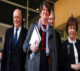 FILE - In this Thursday, April 11, 2019 file photo, Northern Ireland Democratic Unionist Party leader Arlene Foster, center, speaks to journalists after her meeting with European Union chief Brexit negotiator Michel Barnier at EU headquarters in Brussels. (AP Photo/Francisco Seco, File)