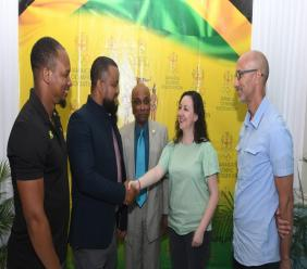 JOA General Secretary and CEO, Ryan Foster (second left), shakes hands with Gisselle Burbano (second right), UNESCO representative, Caribbean Cluster, following the signing of a MOU between both parties recently in Doha, Qatar. Looking on are JOA Board members Michael Frater, President Christopher Samuda and Alan Beckford.