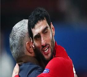 Marouane Fellaini embraces Jose Mourinho.