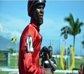 Jockey Omar Walker won aboard SUPERLUMINAL in the seven-and-a-half furlong Fontainbleu Trophy on Monday's Heroes Day at Caymanas Park.