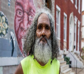Keith Boissiere known as the Baltimore Running Man. Photo Credit: Ras Tre Subira