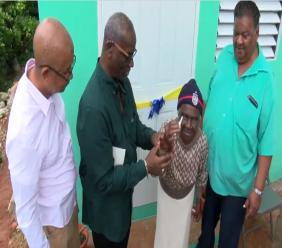The 95-year-old was on Monday presented with the keys to her new home by Local Government Minister Desmond McKenzie and Spanish Town's Mayor Norman Scott.