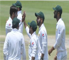 Pakistan celebrate a Hasan Ali wicket.