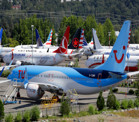 File-This Aug. 15, 2019, file photo shows dozens of grounded Boeing 737 MAX airplanes crowd a parking area adjacent to Boeing Field in Seattle. (AP Photo/Elaine Thompson, File)