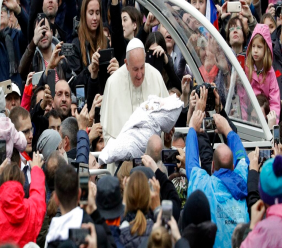 Pope Francis is given a newborn baby to bless as he arrives for his weekly general audience in St. Peter's Square, at the Vatican, November 13, 2019. (AP Photo/Gregorio Borgia)